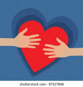 hands holding the heart. charity