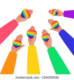 Hands Holding Hearts. LGBTQ+ related symbol in rainbow colors. Gay Pride. Raibow Community Pride Month. Love, Freedom, Support, Peace Symbol. Flat Vector Design Isolated on White Background