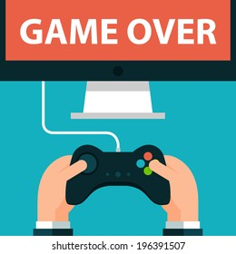 Hands holding joystick and monitor screen Game over