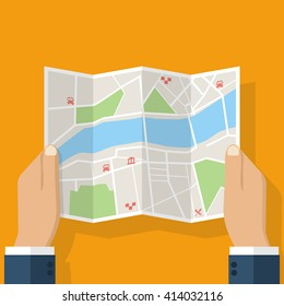 Hands holding paper map. Folded map in hands of men. Tourist look at map of the city to the river, is looking for. Vector Illustration in flat design. Travel concept.