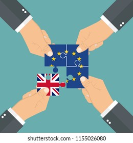 Hands holding puzzle pieces. Three pieces with European flag and one piece with Union Jack. Brexit concept
