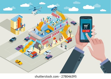 Hands holding a smart-phone. In the touchscreen a mobile applications with buying icon. In the background a Shopping Center in isometric view.