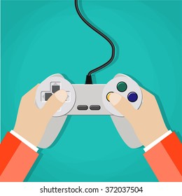 Hands holding wired old school gamepad. vector illustration in flat design on green background