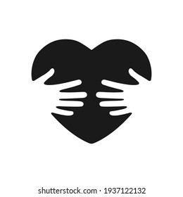 Hands hugging heart vector illustration. Embracing concept. Voluntary symbol black silhouette. World heart Day. Vector isolated on white background.