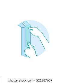 Hands installing weather stripping to door frame