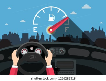 Hands on Steering Wheel with Car Fuel Level Gauge Meter on Front Glass and City on Background