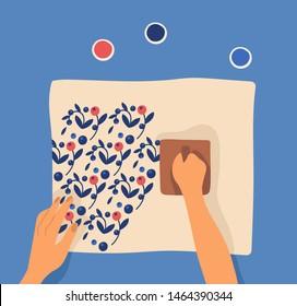 Hands printing pattern on fabric using woodblocks and paint. Leisure or pastime activity, craftwork, handicraft, hobby, workshop, DIY tutorial, craftsmanship. Flat cartoon vector illustration.