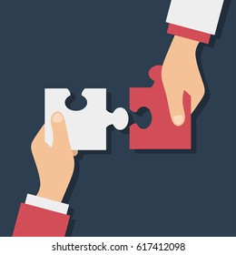 Hands putting puzzle pieces. Teamwork business concept