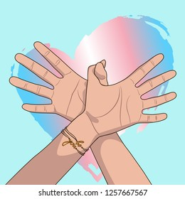 """Hands showing a flying bird, transgender flag colorful heart, bracelet with an inscription """"be you"""" on blue background. Woman hands with fingers simulating a bird in flight. LGBT support card."""