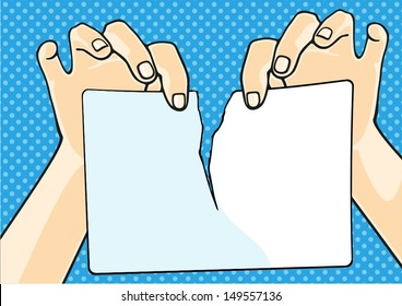 Hands tearing paper