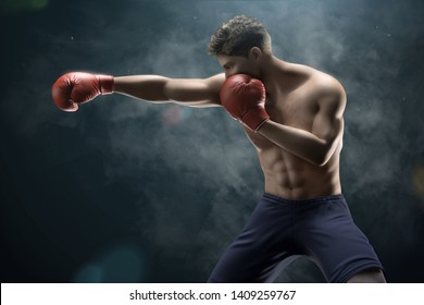 Handsome boxer throwing a right cross in 3d illustration on smog background
