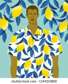 Handsome man in a shirt with lemons print on a lemon tree background.