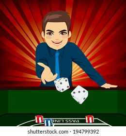 Handsome young man playing craps throwing dice on casino