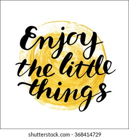 "Handwritten ""Enjoy the little things"" motivation poster with modern calligraphy in hand drawn gold painted spot"