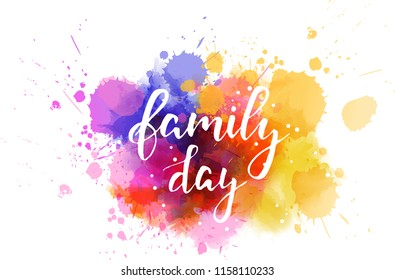 """Handwritten modern calligraphy text """"Family day"""" on abstract watercolor splash blot.  Family holiday concept."""