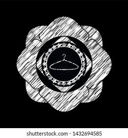 hanger icon inside chalkboard emblem written on a blackboard