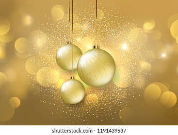 Hanging Christmas baubles on a golden bokeh lights background
