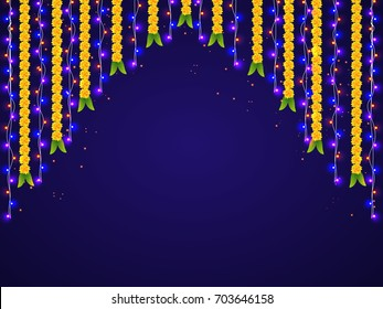 Hanging colorful lights and marigold flowers decorations for Happy Diwali celebrations.