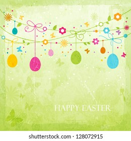 Hanging Easter eggs, flowers, butterflies and colorful dots on green textured background forming a happy, colorful border with space for your text. Great for the coming Easter celebration.