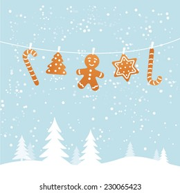 Hanging ginger breads in snowy winter scene