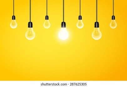 Hanging light bulbs with glowing one on a yellow background, copy space. Vector illustration for your design