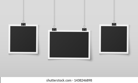 Hanging photo frames. Blank photos frame hangs on ropes with clips, wall memory, retro image memories album. Realistic vector design isolated empty square picture or foto