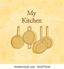 Hanging Pots and Pans in Front of yellow wooden wall in kitchen