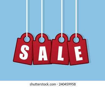Hanging red tags spelling out sale