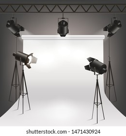 Hanging and standing spotlights illuminate the white cyclorama for photography and the stage with bright light. Realistic vector illustration of spotlight in photo studio.