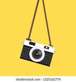 Hanging vintage camera. Vector illustration.