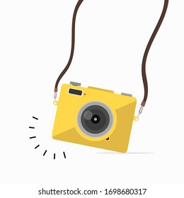 Hanging yellow camera in a flat style