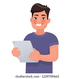 Happy Asian man holding a tablet in his hands. People and gadgets. Vector illustration in cartoon style