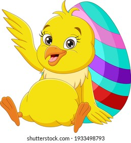 Happy baby chick with Easter eggs