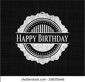 Happy Birthday chalk emblem written on a blackboard
