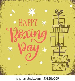 Happy boxing day, vector illustration with doodle gift boxes and hand lettering phrase