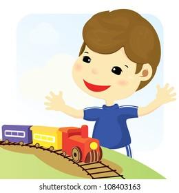 Happy boy is playing toy train
