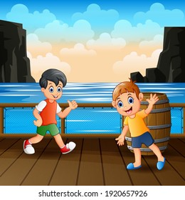 Happy boys playing on the wooden port