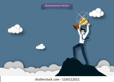 Happy businessman holding a number one trophy on the top of the high mountain. Success, goal, achievement and challenge concept.