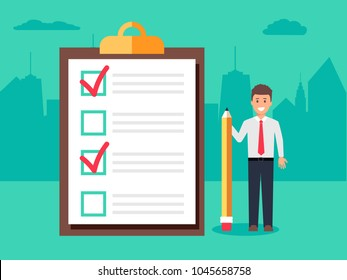 Happy businessman holding a pencil near completed checklist