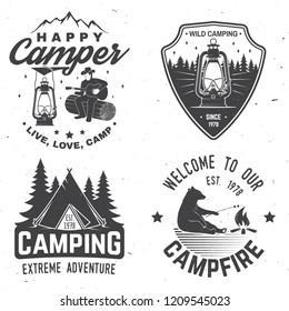 Happy camper. Vector illustration. Concept for shirt or logo, print, stamp or tee. Vintage typography design with lantern, camping tent, campfire, bear, man with guitar and forest silhouette.