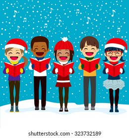Happy children friends from different ethnicities singing carols at Christmas night