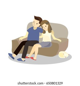 Happy couple sitting on a love seat couch watching movie or tv together with a pet cat sleeping