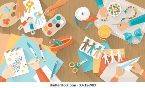 Happy creative kids playing, painting, cutting paper, sketching, hands top view, education and enjoyment concept