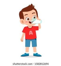 happy cute kid boy drink fresh milk