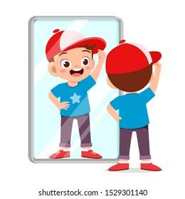 happy cute kid boy use mirror in morning
