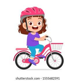 happy cute kid girl riding bike smile