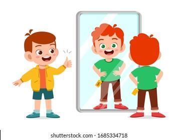 happy cute little kid boy choose a clothes