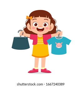 happy cute little kid girl choose clothes