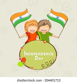 Happy cute little kids holding Indian National Flags in their hands on abstract grey background for 15th of August, Independence Day celebrations.