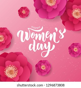 Happy Woman's Day hand lettering text with beautiful flowers. Vector illustration. 8 March greeting calligraphy design. Template for a poster, cards, banner.